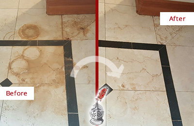 Before and After Picture of a Medina Hard Surface Restoration Service on a Marble Floor to Eliminate Rust Stains